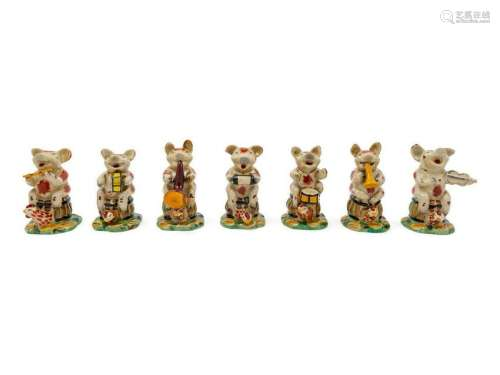 A Porcelain Pig Band comprising 7 musicians.