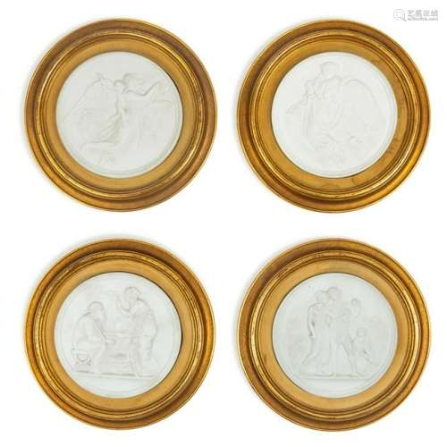 A Group of Four Bisque Plaques  each set in a