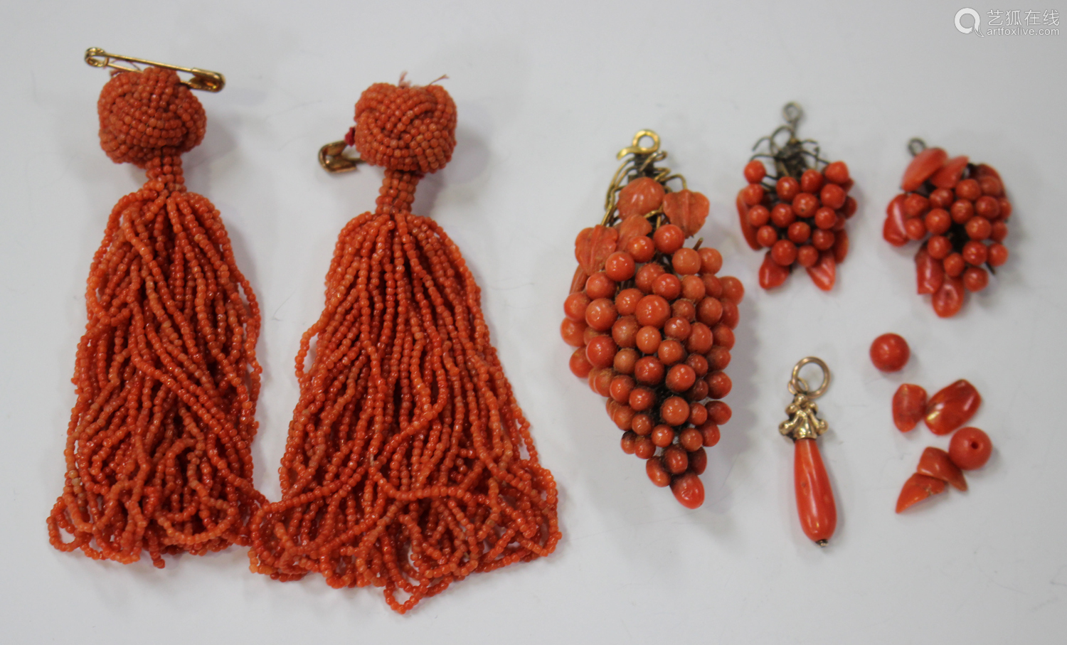 A group of coral jewellery, comprising a pair of pendant tassels, length 7cm, a brooch, designed