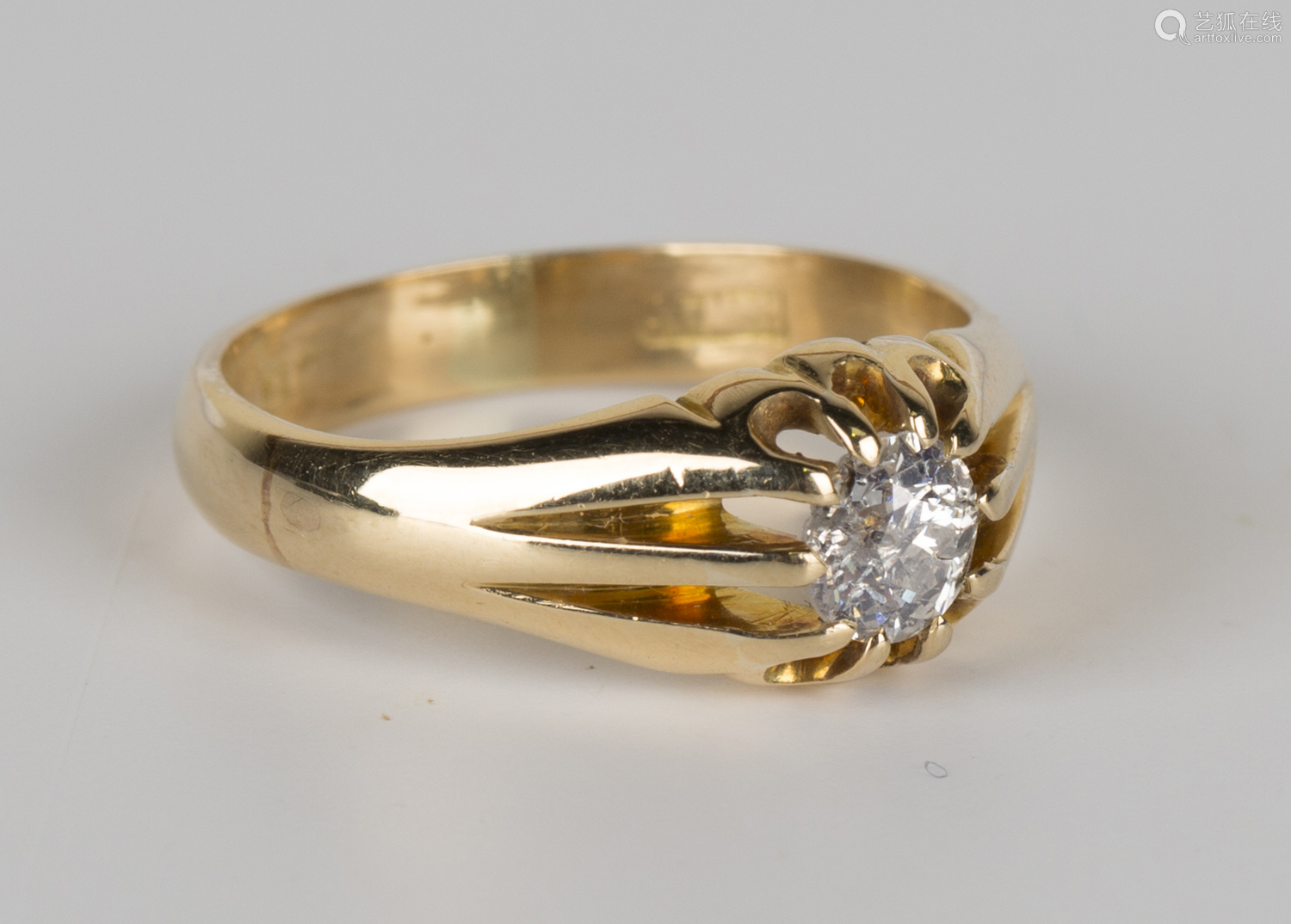 An 18ct gold and diamond single stone ring, claw set with a circular cut diamond, ring size approx