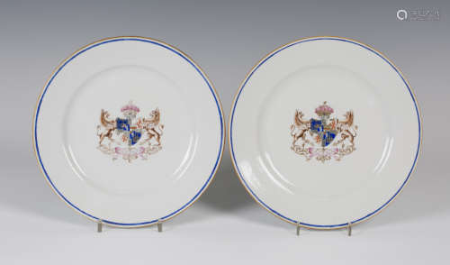 A pair of Chinese armorial porcelain plates, 19th century, each centre enamelled and gilt with a