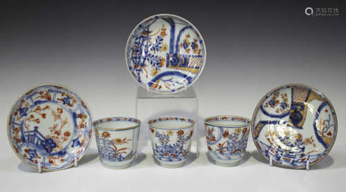 A set of three Chinese Imari porcelain cups and two saucers, Kangxi period, each painted and gilt