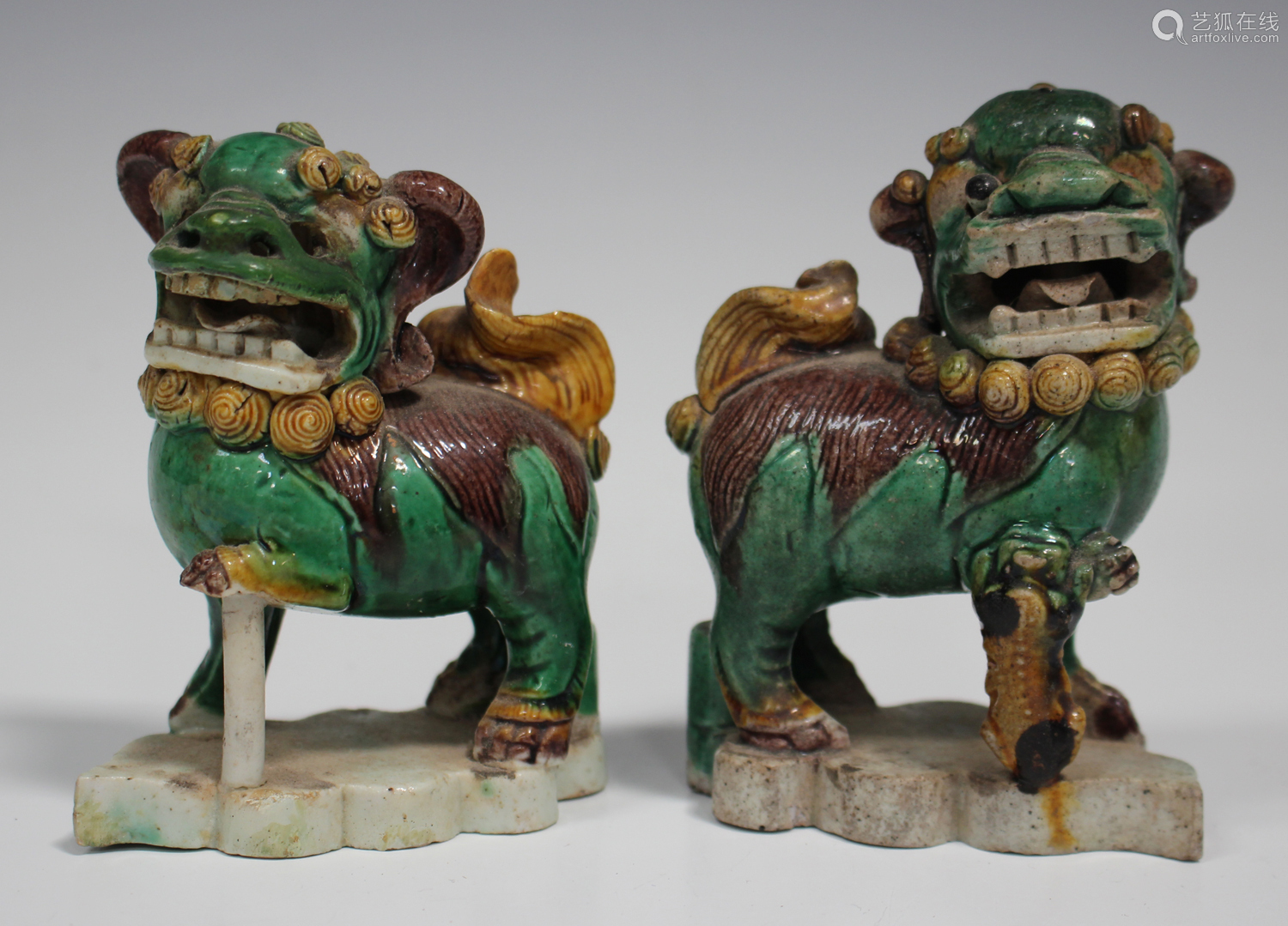 A pair of Chinese famille verte enamelled biscuit porcelain jostick holder figures of Buddhistic