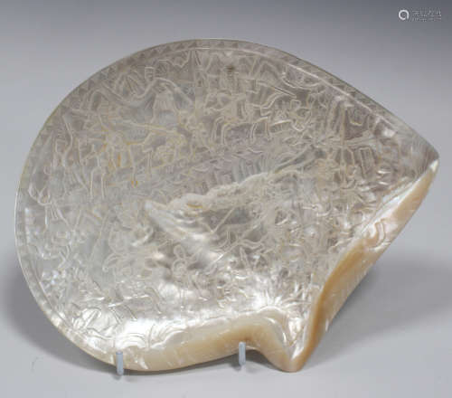 A Chinese carved mother-of-pearl shell panel, late Qing dynasty, one side carved in low relief