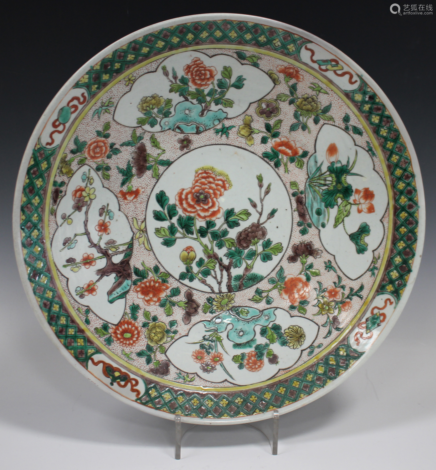A Chinese famille verte porcelain circular dish, early 20th century, painted with panels of peonies,