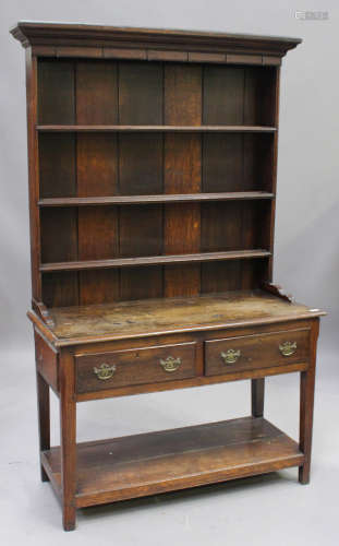 A 19th century oak dresser, the shelf back above two frieze drawers, on chamfered supports united by