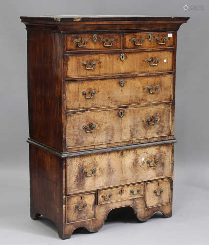 A George I walnut chest-on-stand, the moulded top above two short and three long drawers, the base