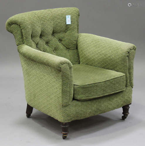 A late Victorian tub back armchair, upholstered in green fabric, on turned legs, height 79cm,