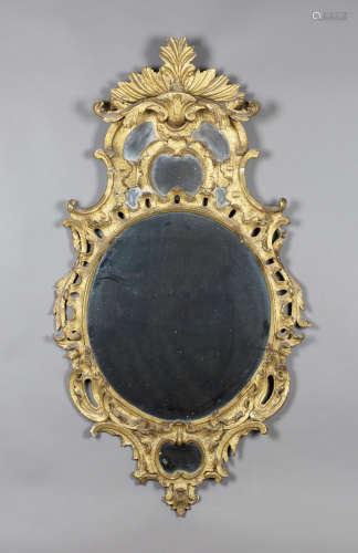An 18th century Rococo giltwood framed wall mirror with leaf and scroll decoration, 123cm x 66cm.
