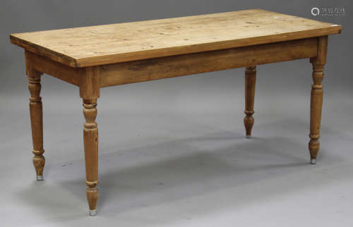 A 20th century pine kitchen table, the rectangular top raised on turned legs, height 76cm, length