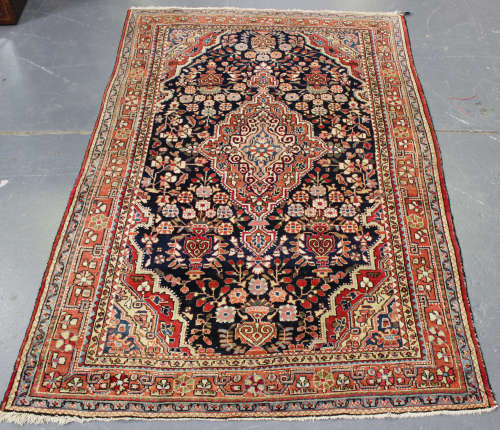 A Heriz rug, North-west Persia, early/mid-20th century, the midnight blue field with a shaped