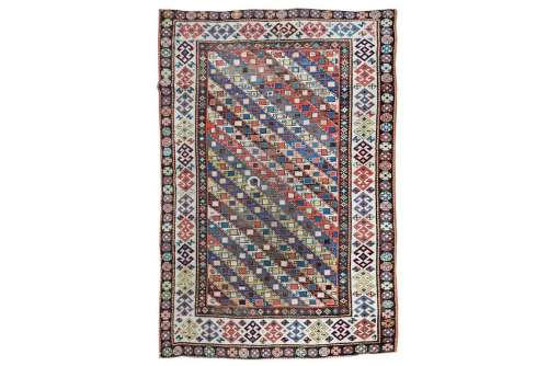 AN ANTIQUE GENJE RUG, SOUTH CAUCASUS