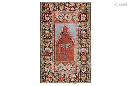 AN ANTIQUE TURKISH PRAYER RUG
