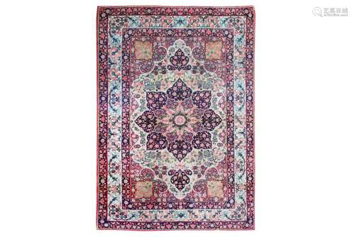 AN ATIQUE KIRMAN LAVER RUG, SOUTH PERSIA