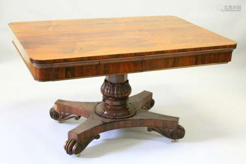 A REGENCY ROSEWOOD LIBRARY TABLE, with rounded