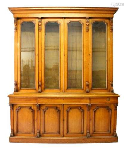 A VICTORIAN OAK LIBRARY BOOKCASE, with a moulded