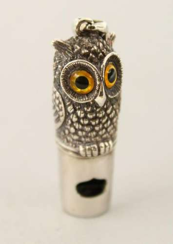 A SILVER OWL WHISTLE.