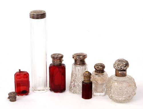 Mixed Lot: six various silver lidded toiletry bottles including two ruby glass scent bottles (both