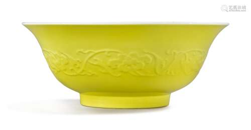 A RARE AND LARGE MOLDED LEMON YELLOW-BACKED FAMILLE-ROSE 'PEACH' BOWL YONGZHENG MARK AND PERIOD