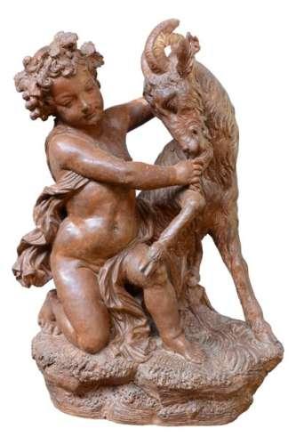Statue en terre cuite représentant un jeune Bacchu…