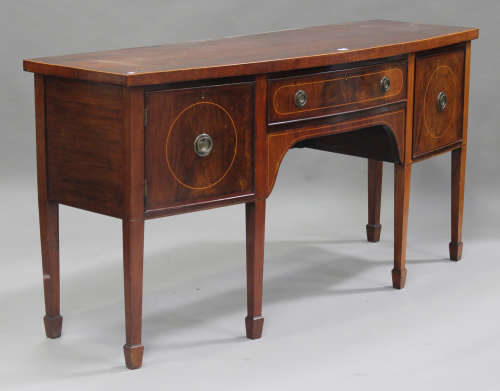 An early 20th century George III style mahogany bowfront sideboard, fitted with a cupboard and two