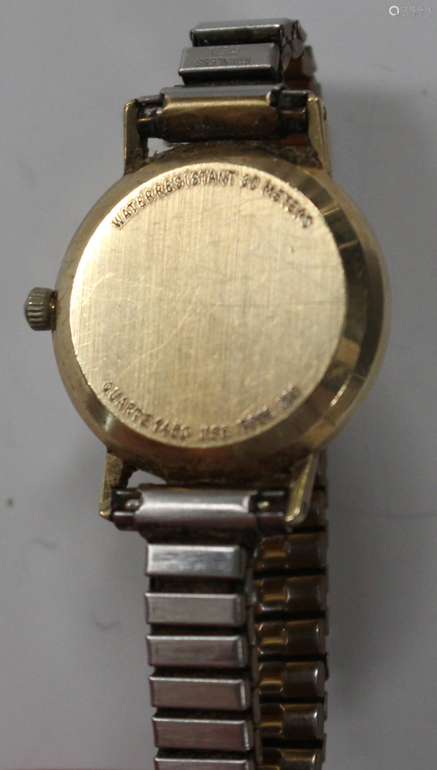 An Omega Quartz lady's wristwatch, the signed silvered dial with black baton hour markers, case