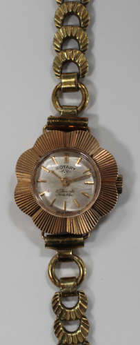 A Rotary 9ct gold flowerhead shape cased lady's wristwatch with an unsigned jewelled movement,