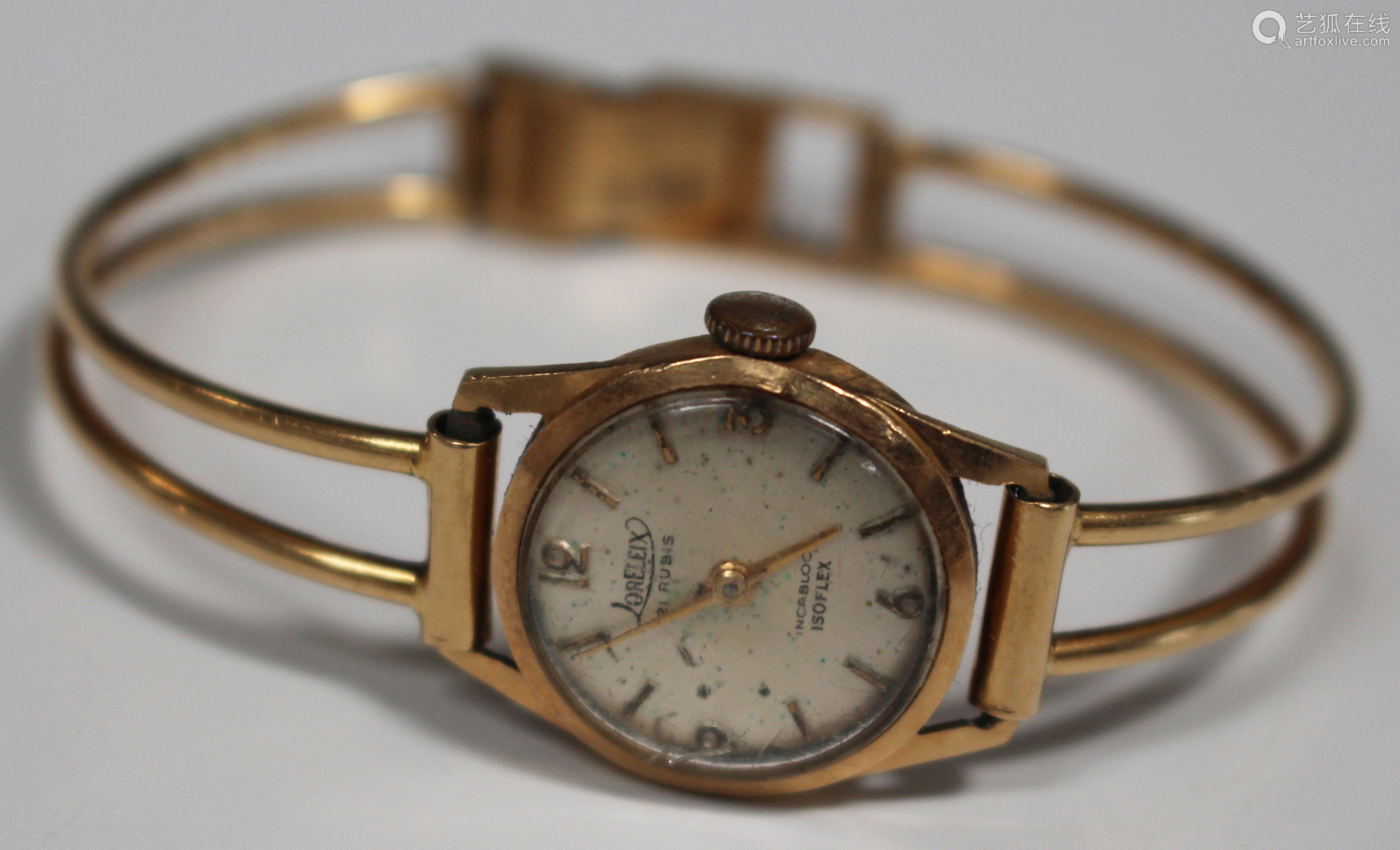 A Loreleix Isoflex gold cased lady's wristwatch, the case back detailed '18K 0,750', on a curved bar