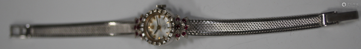 A white gold, diamond and synthetic ruby lady's bracelet wristwatch, the silvered dial with baton