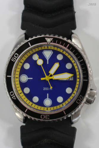 A Seiko Diver's wristwatch, the unsigned blue dial with day-of-the-week and date-of-the-month