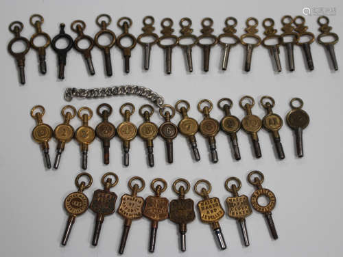 A collection of thirty-seven pocket and fob watch keys, including eight advertising watch keys and