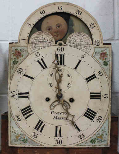 An early 19th century oak longcase clock with eight day movement striking on a bell, the painted
