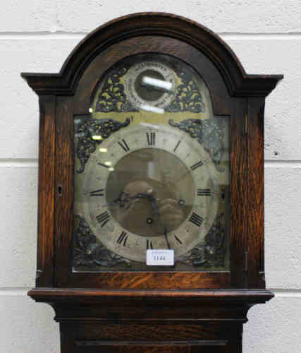 A George V oak diminutive longcase clock with eight day movement chiming on gongs, the brass break