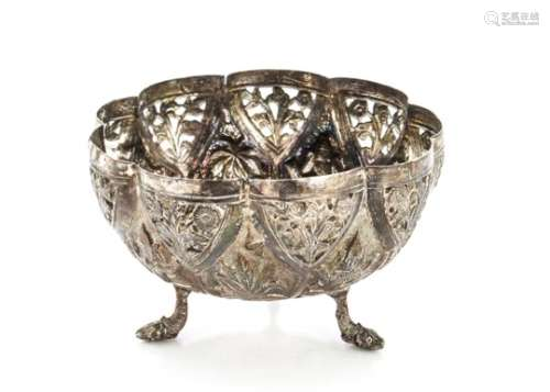 An early 20th century Indian silver bowl, ornately decorated with raised designs and pierced