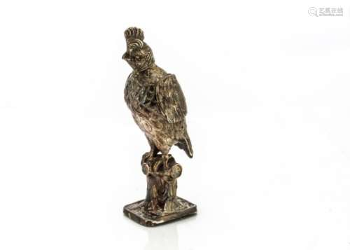 A George V silver model of a bird, import marks for London 1924, by SBL, the crested bird with