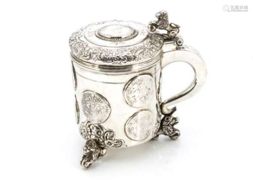 An 18th century Norwegian silver tankard, three lion and ball supports with raised and engraved