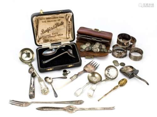 A small collection of silver and silver plate, including a silver napkin ring and gilt spoon, and