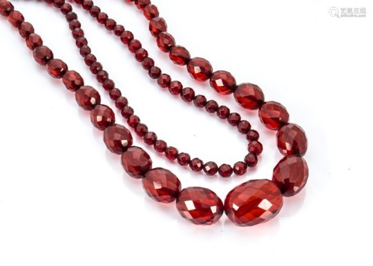A cherry amber style graduated faceted bead necklace, 84cm, together with another uniform faceted