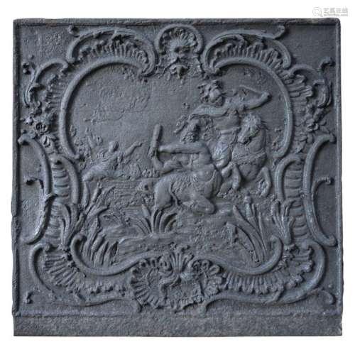 Plaque de cheminée en fonte représentant une scène…