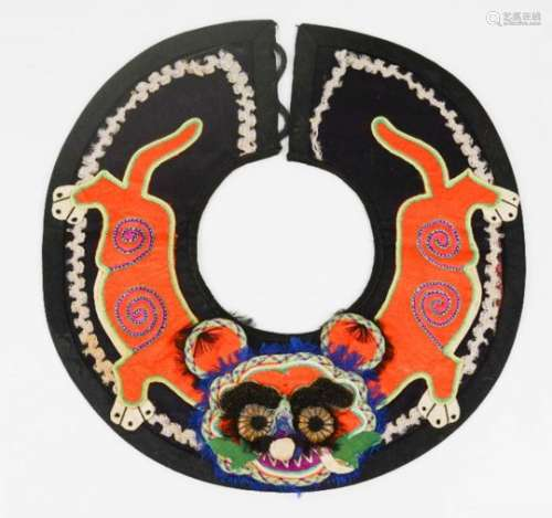An early 20th century Chinese boy's tiger collar for protection, embroidered and applique work and