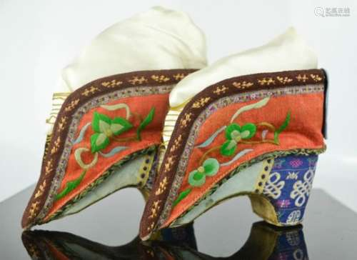 A pair of Chinese bound feet shoes or 'lotus shoes', late Qing Dynasty, circa 1900, hand embroidered