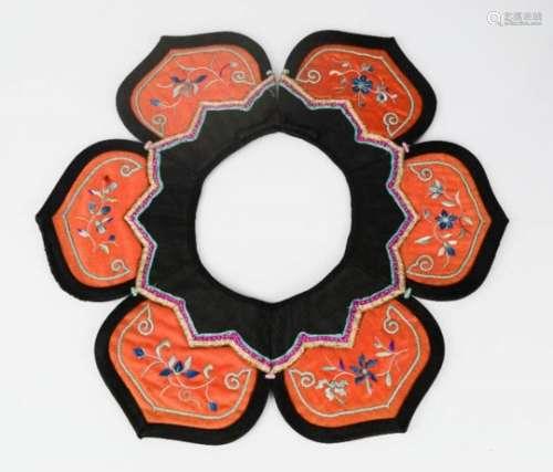 A late 19th century Chinese silk cloud collar, three blues 'San Lan' 30cm diameter.