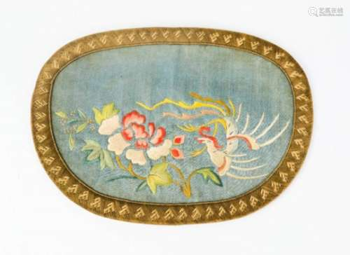 A 19th century silk purse, embroidered to depict a pheonix (Reng-Huang), 12 by 16½cm.