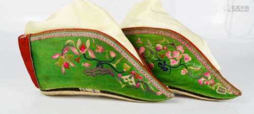 A pair of Chinese lotus shoes, circa 1920, green silk embroidered with dragon, butterfly and
