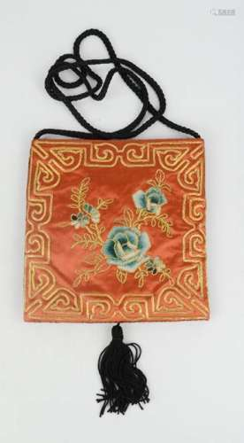 A Chinese embroidered panel made into a bag, floss silk peonies and couched border in gold, circa