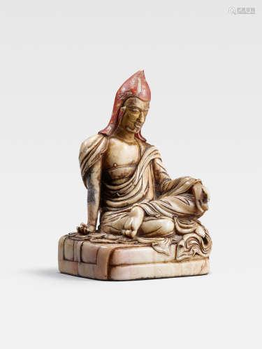A POLYCHROMED SOAPSTONE FIGURE OF A PANDITA  TIBETO-CHINESE, CIRCA 17TH CENTURY