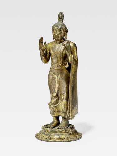 A GILT COPPER ALLOY FIGURE OF BUDDHA  SRI LANKA, DIVIDED KINGDOMS PERIOD, 13TH/14TH CENTURY