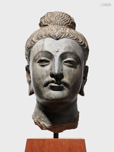 A LARGE SCHIST HEAD OF BUDDHA   ANCIENT REGION OF GANDHARA, 3RD/4TH CENTURY