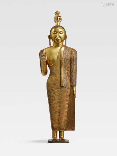 A GILT COPPER ALLOY FIGURE OF BUDDHA  SRI LANKA, KANDYAN PERIOD, 18TH CENTURY