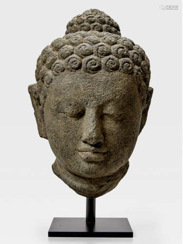 AN ANDESITE HEAD OF BUDDHA  INDONESIA, CENTRAL JAVA, 9TH CENTURY